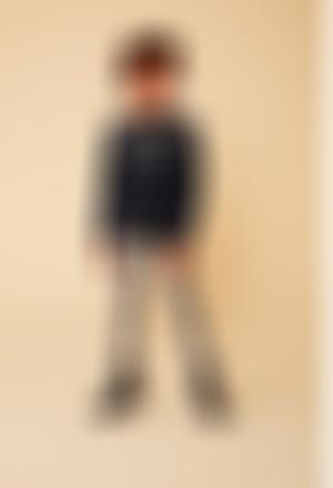 Jersey tricotosa con guipur de niña
